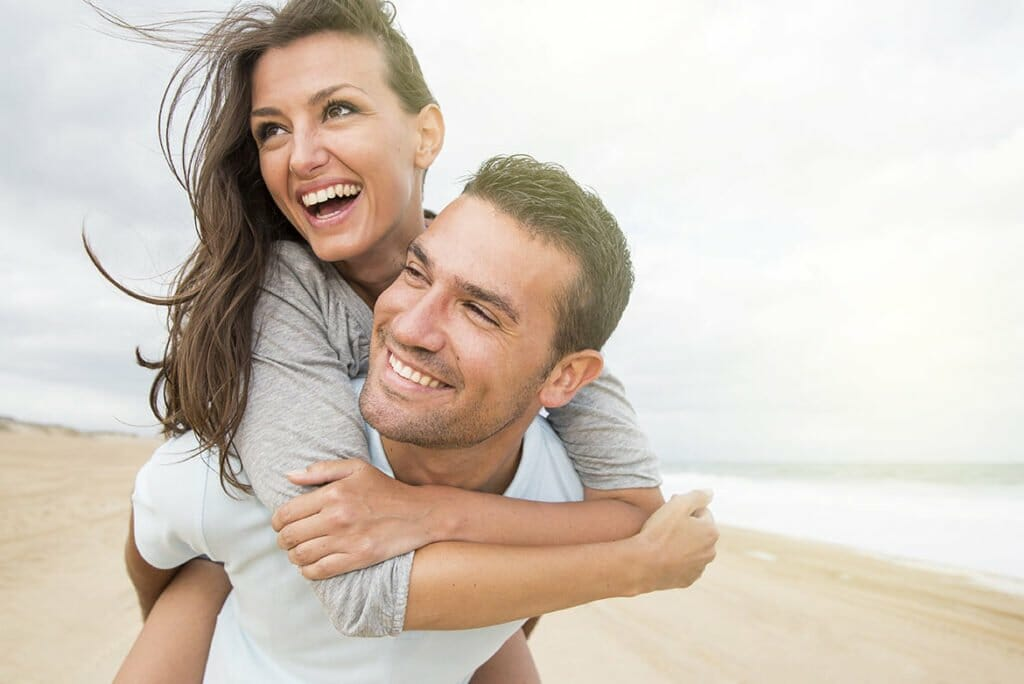 Couple on Beach after Be Happy IV Vitamin Therapy and Shots Spa Treatment in Lamont, Illinois at Solana Aesthetics and Wellness